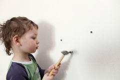 Child with hammer Stock Images