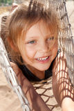 Child in hammock. Portrait of happy little girl in hammock Stock Photography