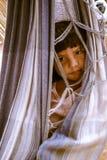 Child in hammock in Bolivia Stock Photography
