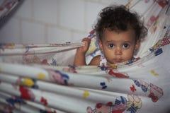 Child in hammock, Brazil. Royalty Free Stock Image