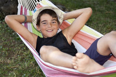 Child in the hammock. Holiday royalty free stock images