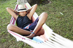 Child in the hammock. Holiday Stock Photo