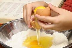 Child hand breaking egg Stock Photography