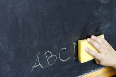 Child hand cleans letters abc education background Stock Photo