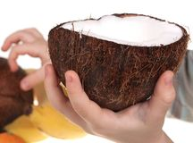 Child hand with coconut royalty free stock images