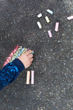 Child hand with colorful chalk Stock Photos