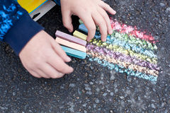 Child hand with colorful chalk Royalty Free Stock Photos