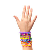 Child hand with colorful rubber rainbow loom bracelets isolated Stock Images
