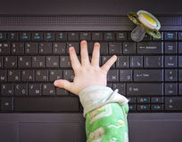 Child hand and computer Stock Photo