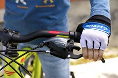 Child hand with Craft glove on handlebars with Shimano speed shi. Tambov, Russian Federation - May 07, 2017 Child hand with Craft glove on handlebars with Royalty Free Stock Photography