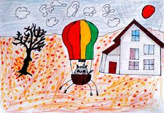 Child hand drawing. Cat in a hot air balloon ready to fly in aut Stock Photography
