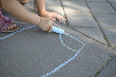 Child hand drawing with chalk Royalty Free Stock Photography