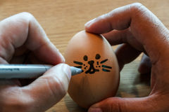 Child hand drawing easter egg with pen Royalty Free Stock Photography
