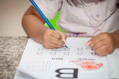 Child hand drawing her homework Royalty Free Stock Images