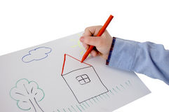 Child hand drawing a picture Royalty Free Stock Photography