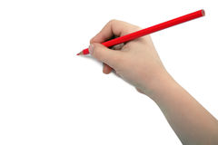Child hand draws a red pencil. Isolated on white background Stock Image