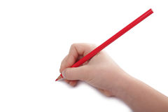 Child hand draws a red pencil. Horizontal. Child hand draws a red pencil. Isolated on white background Royalty Free Stock Images