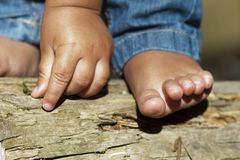 Child hand and foot outdoors. Child foot and hand in the forest. Barefoot Stock Photos