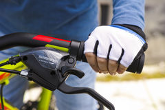 Child hand with glove on handlebars with Shimano speed shift and. Tambov, Russian Federation - May 07, 2017 Child hand with glove on handlebars with Shimano stock images
