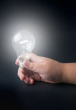 Child hand hold bulb light Stock Images