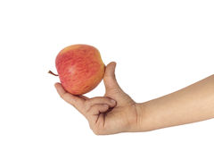 Child hand holding apple Stock Photo