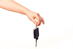 Child hand holding a car key Stock Photo