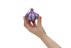 Child hand holding christmas decoration Royalty Free Stock Images