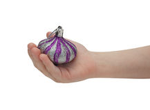 Child hand holding christmas decoration Stock Photos