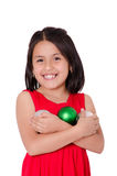 Child Hand holding a christmas ornament Royalty Free Stock Photo