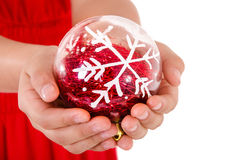 Child Hand holding a christmass ornament Stock Photo