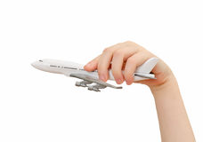 Child hand holding model airplane. Stock Images