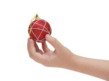 Child hand holding red christmas ball Stock Photo