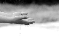 Child hand holding water. The child hand with water Royalty Free Stock Photography