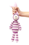 Child hand holds funny knitted rabbit toy isolated Stock Image