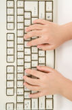 Child hand and Keyboard Royalty Free Stock Photo