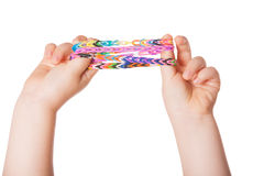 Child Hand with Loom strap Stock Photos