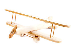 Child hand made wooden aircraft  over white Stock Photo