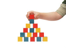 Child hand make a building of blocks Royalty Free Stock Photo
