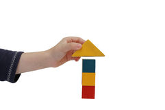Child hand make a building of blocks Royalty Free Stock Image