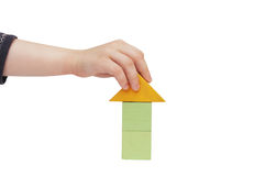Child hand make a building with colored blocks Stock Images