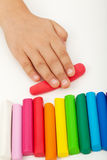 Child hand with modeling clay. Child hand with colorful modeling clay bars Royalty Free Stock Image