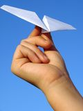 Child hand with paper plane Royalty Free Stock Photos