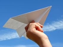 Child hand with paper plane Royalty Free Stock Image