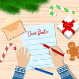 Child Hand with pen Writing letter to santa claus. Royalty Free Stock Photo