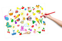 Child hand with pencil draw a picture Stock Photos