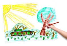 Child hand with pencil draw a picture Royalty Free Stock Images
