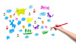 Child hand with pencil draw a picture Stock Photo