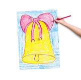 Child hand with pencil draw a picture Stock Image