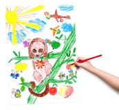 Child hand with pencil draw a picture Royalty Free Stock Photo