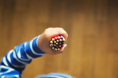 Child hand with pencils, back to school Royalty Free Stock Photography